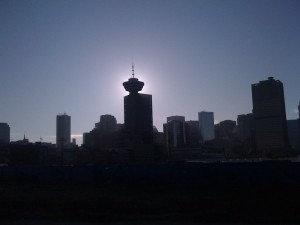 Sun behind harbour center
